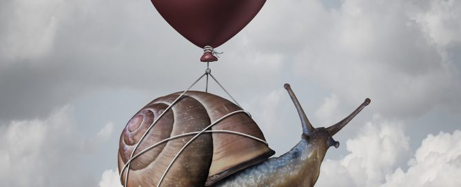 Success concept and business advantage idea or game changer symbol as a balloon lifting up a slow generic snail as a new strategy and innovation metaphor for creativethinking.